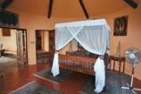 afrikanisch eingerichtete Suite in Kutazama