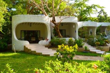 Bungalow-Zimmer im Garten des Ocean Village Clubs