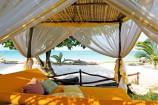 Tagesbett am Strandabschnitt des Afrochic Boutiqe Hotels